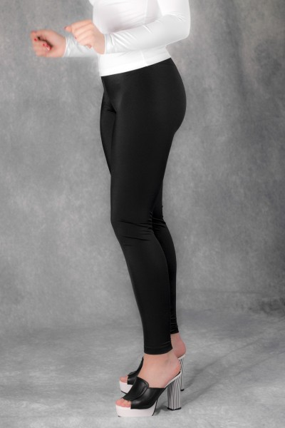 634bc40a08da6 Incredibly smooth and cozy shiny spandex leggings in black color. Leggings  in a stretchy fabric with an elasticated waist. These leggings are going to  be ...
