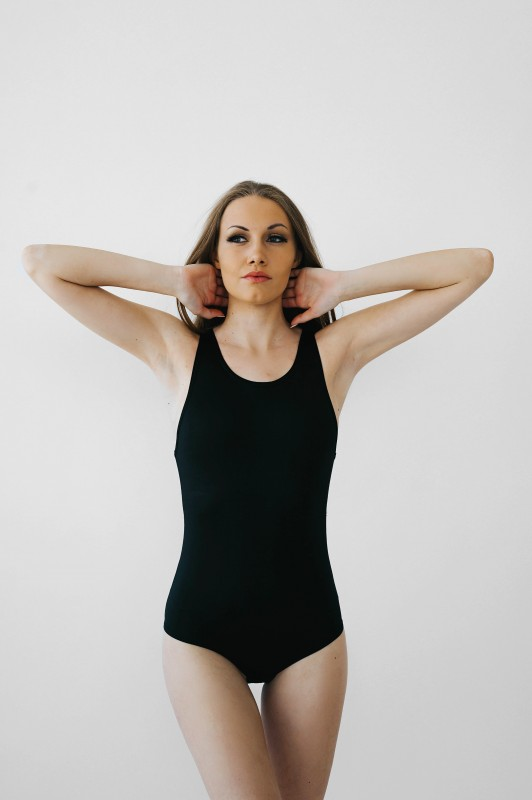 Women's body suit with crotch Hooks